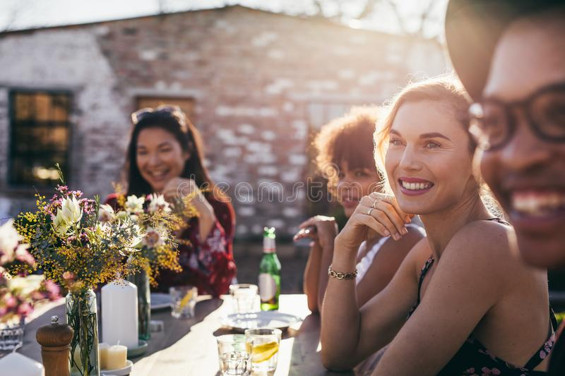 Beautiful young woman having party with friends royalty free stock photos