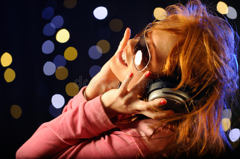 Beautiful young woman with headphones stock image
