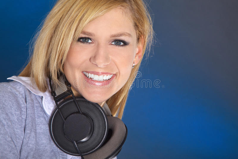 Beautiful young woman with headphones stock photos