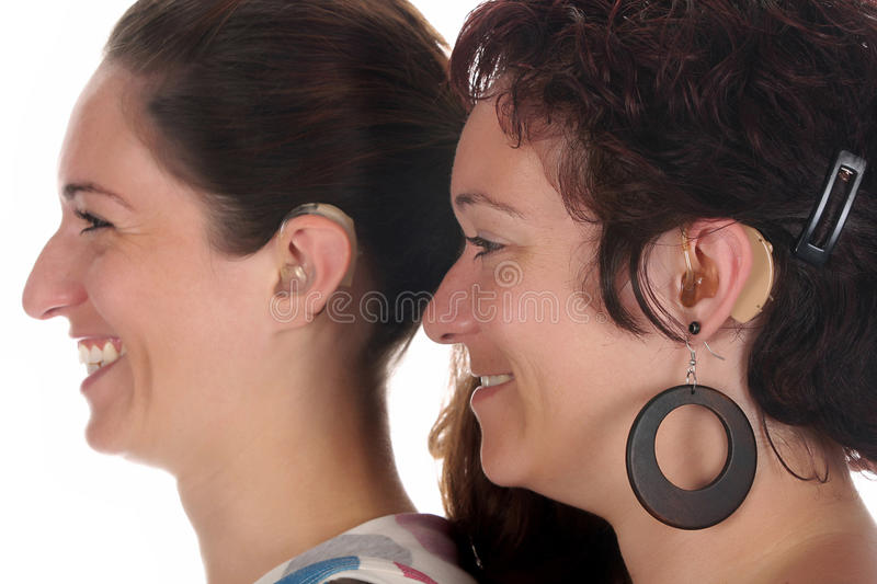 Beautiful young woman with Hearing Aid royalty free stock image