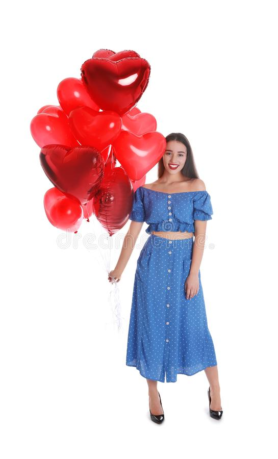 Beautiful young woman with heart shaped balloons isolated. Valentine`s day celebration royalty free stock photo