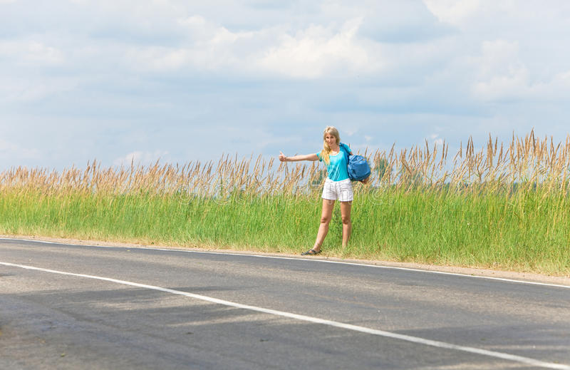 Beautiful Young Woman Hitch Hiking- In Auto-stop Stock Photography