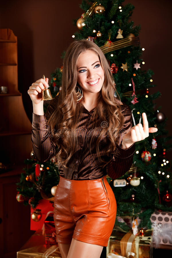 Beautiful young woman holding a bell at Christmas Eve stock photos