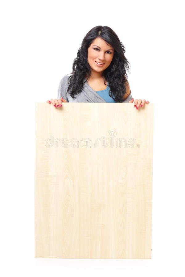 Beautiful young woman holding a blank wooden board royalty free stock photography