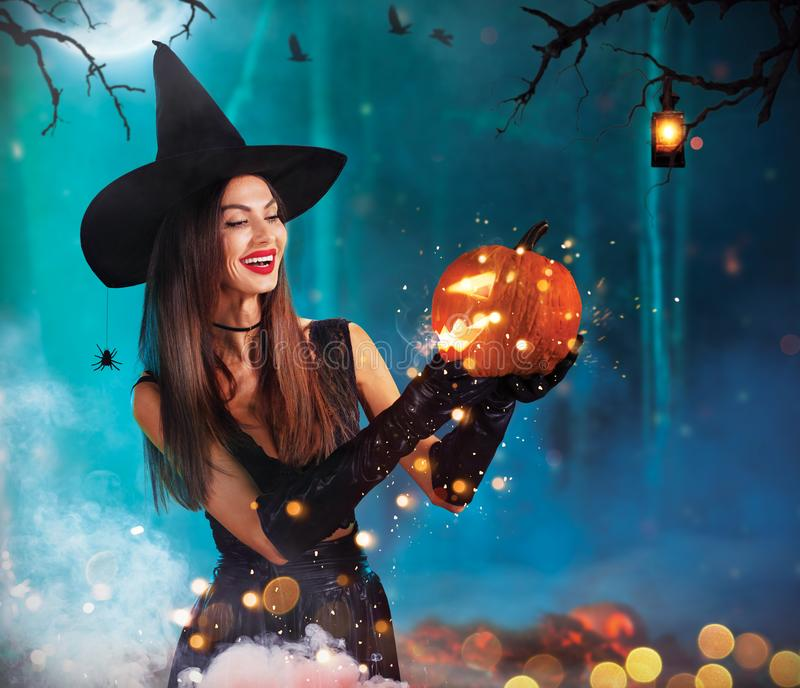 Beautiful young woman holding carved pumpkin stock photography