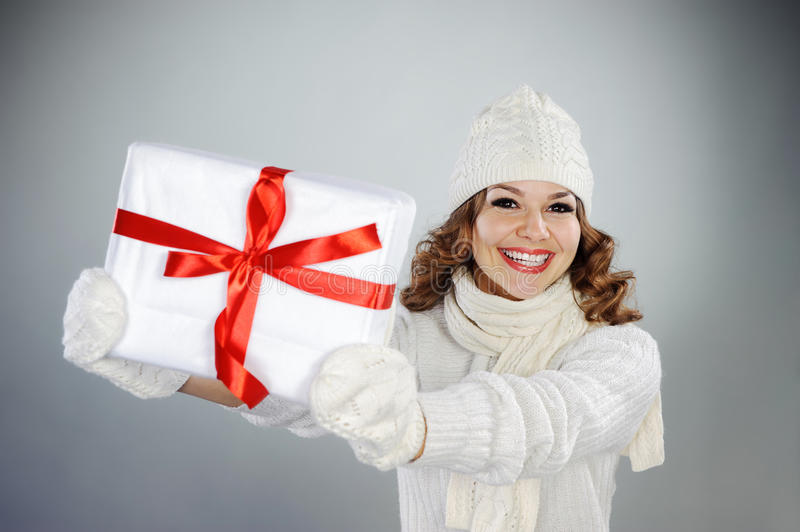 Beautiful young woman holding Christmas present royalty free stock photography