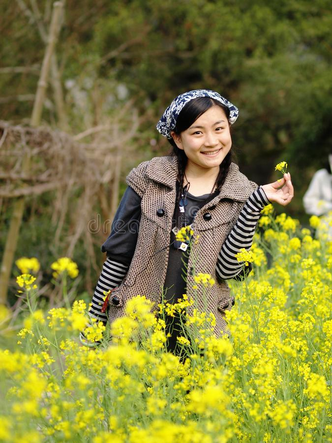 Download Beautiful Young Woman Holding Flower Stock Photo - Image of asian, human: 13620566