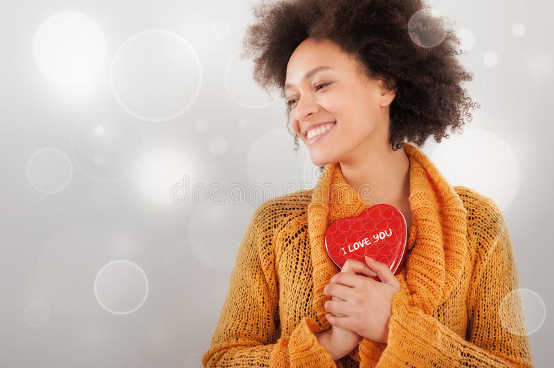 Beautiful young woman holding her gift box stock photo