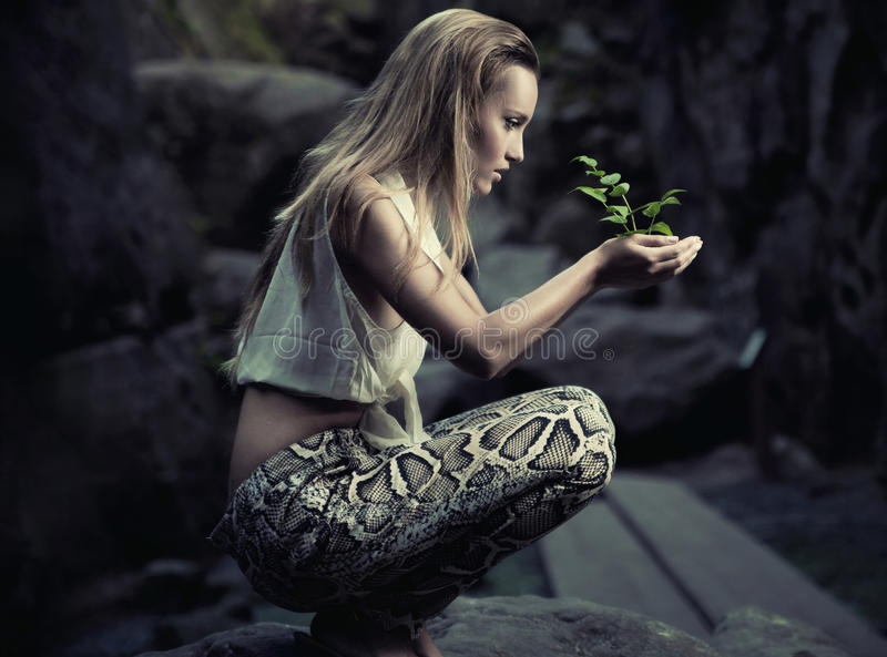 Beautiful Young Woman Holding A Plant Royalty Free Stock Image