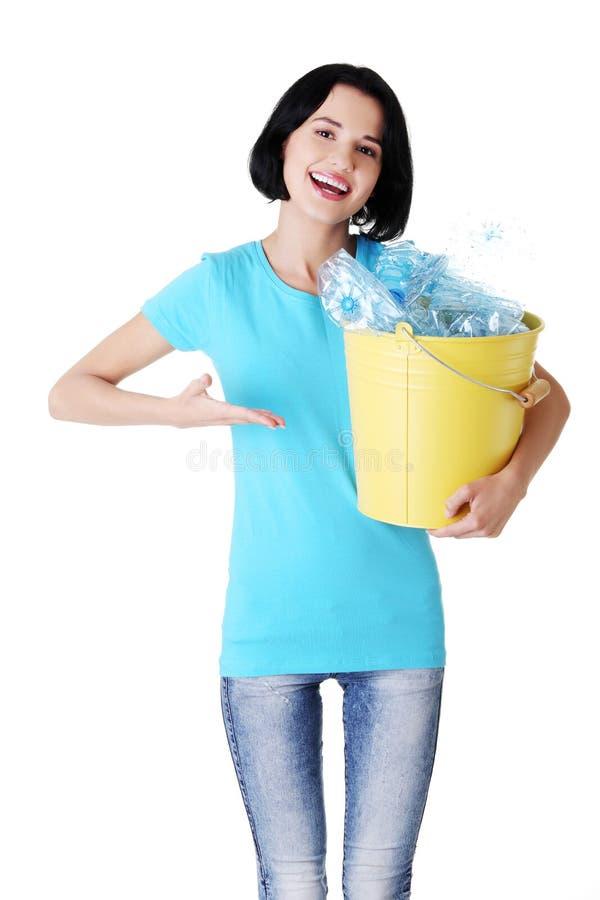 Download Beautiful Young Woman Holding Recycling Bin Stock Photo - Image: 28393578