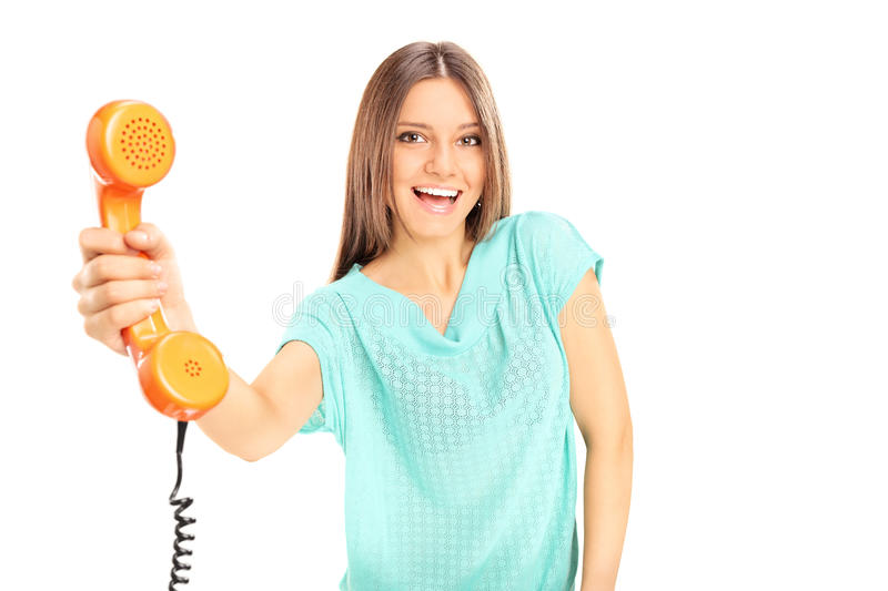 Beautiful young woman holding a telephone stock photography