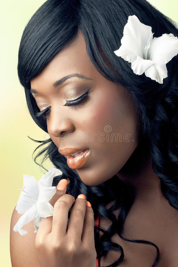 Beautiful young woman holding a white flower royalty free stock photography