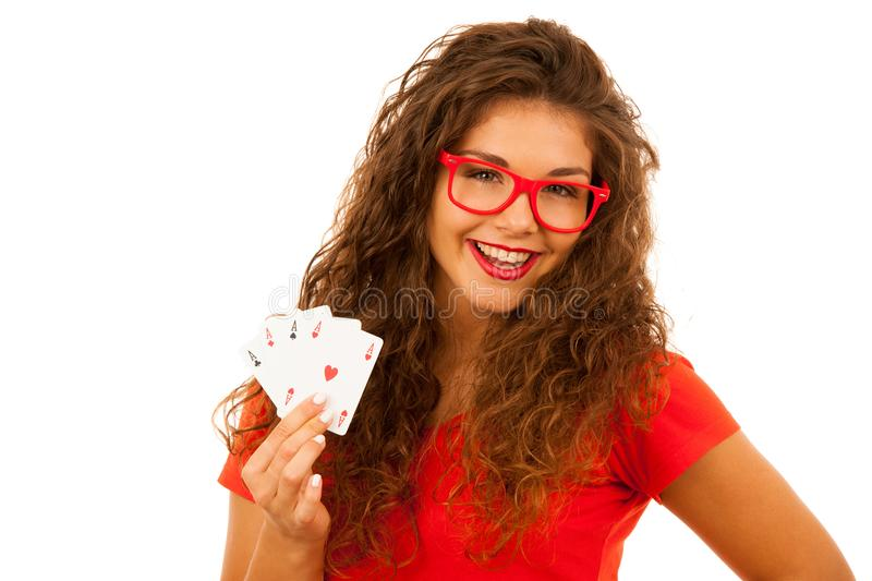 Beautiful young woman holds poker cards four aces isolated over stock photography