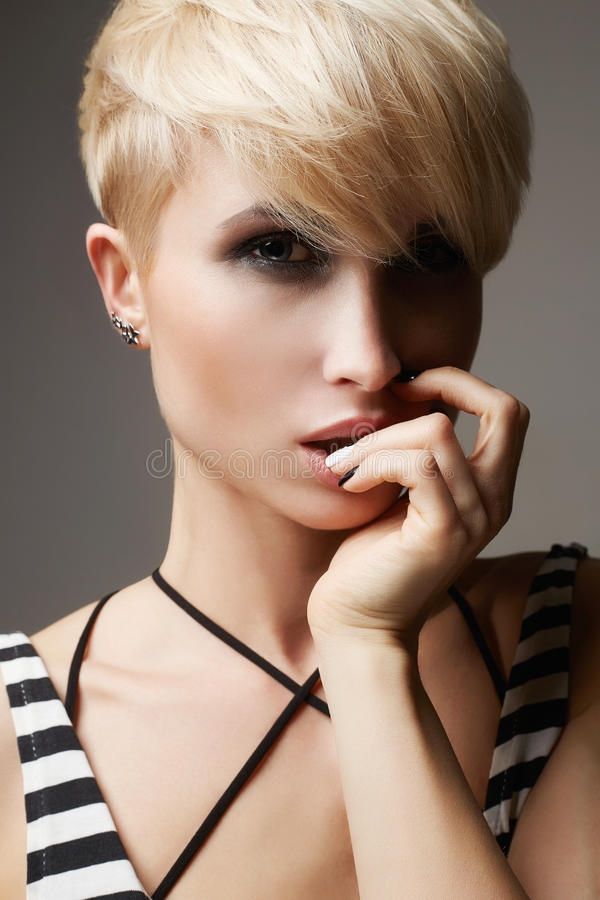 Beautiful young woman with hort haircut royalty free stock photos