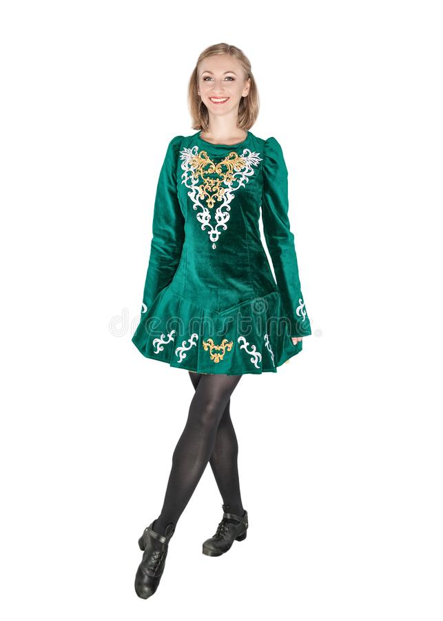 Beautiful young woman in Irish dance green dress isolated royalty free stock photography