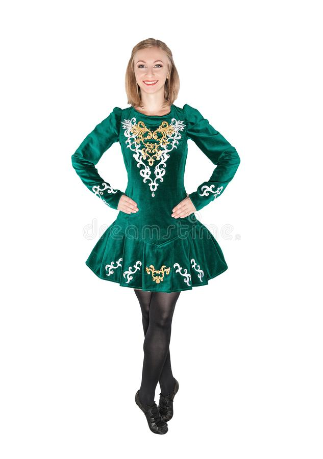Beautiful young woman in Irish dance green dress isolated. On white royalty free stock photo