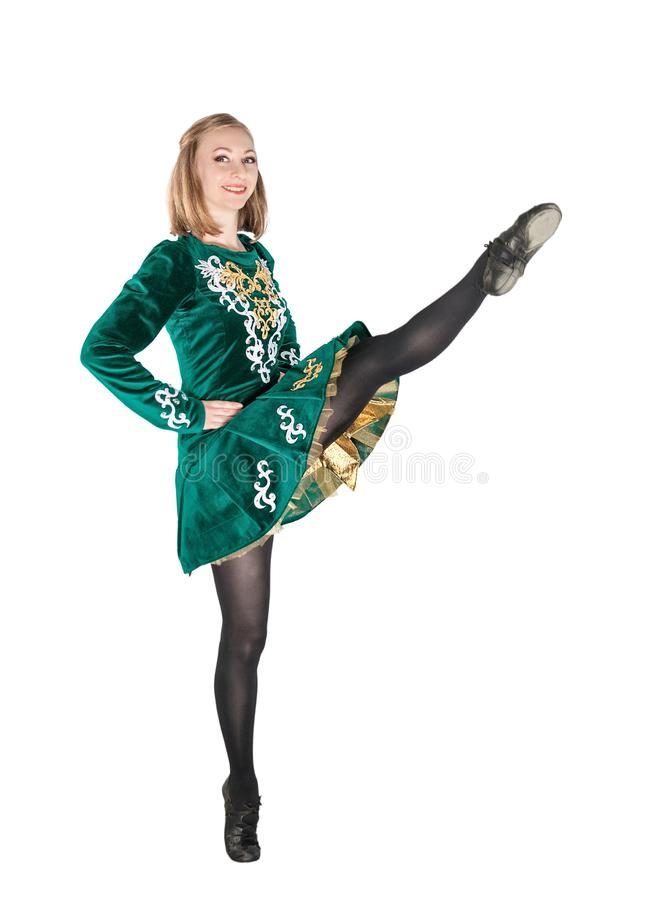 Beautiful young woman in Irish dance green dress jumping isolate. D on white royalty free stock photos