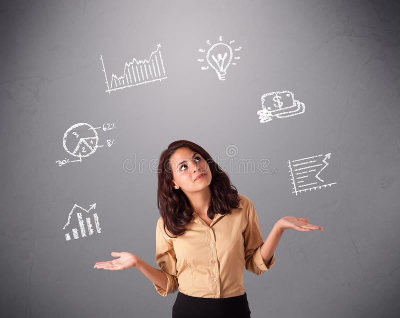 Beautiful young woman juggling with statistics and graphs royalty free stock image