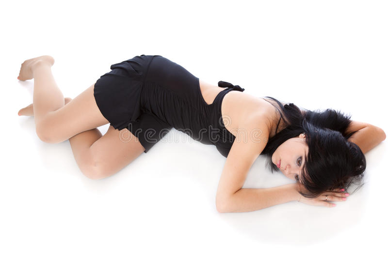 A beautiful young woman is laying on the floor royalty free stock photography