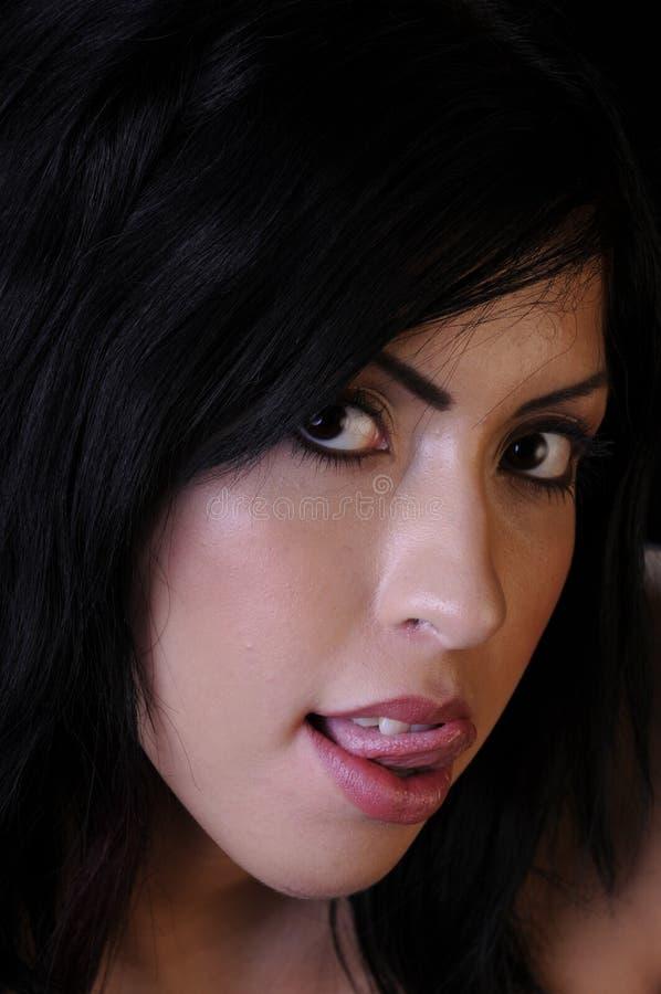Beautiful Young Woman Licking Lips Stock Photography