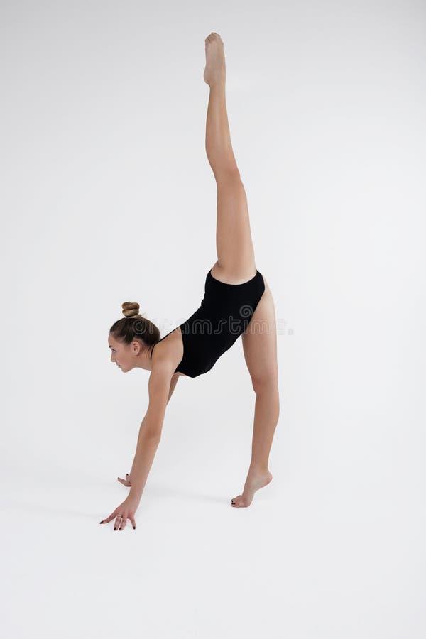 Beautiful young woman limber exerciser in the studio stock photos
