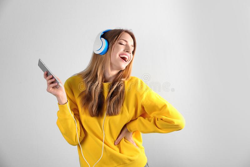 Beautiful young woman listening to music stock images