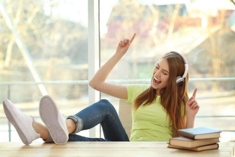Beautiful young woman listening to music royalty free stock photos