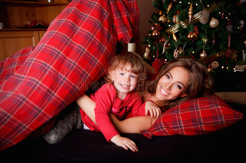 Beautiful young woman with a little girl stock images