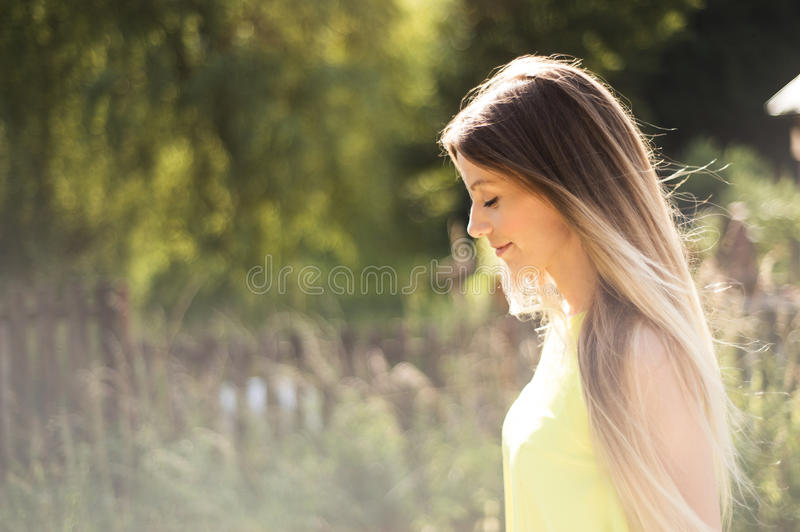 Beautiful young woman with long blonde hair. Sunny summer. stock photography