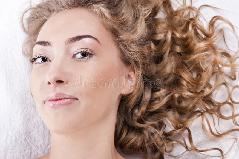 Beautiful Young Woman With Long Curly Hair Royalty Free Stock Photos