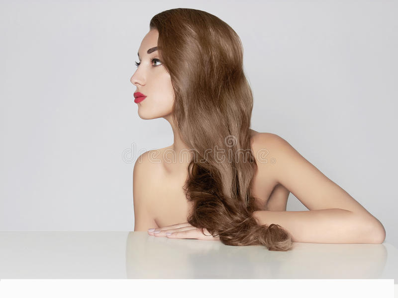 Beautiful young woman with long hair royalty free stock photo