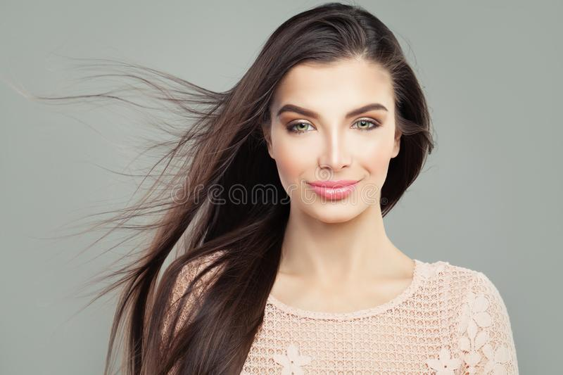 Beautiful young woman with long straight blowing hair stock photos