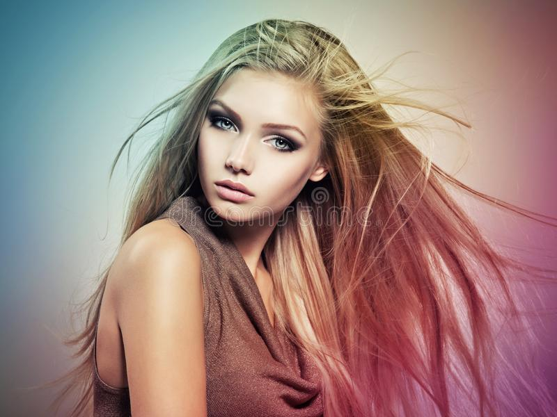 Beautiful young woman with long straight white hair stock image