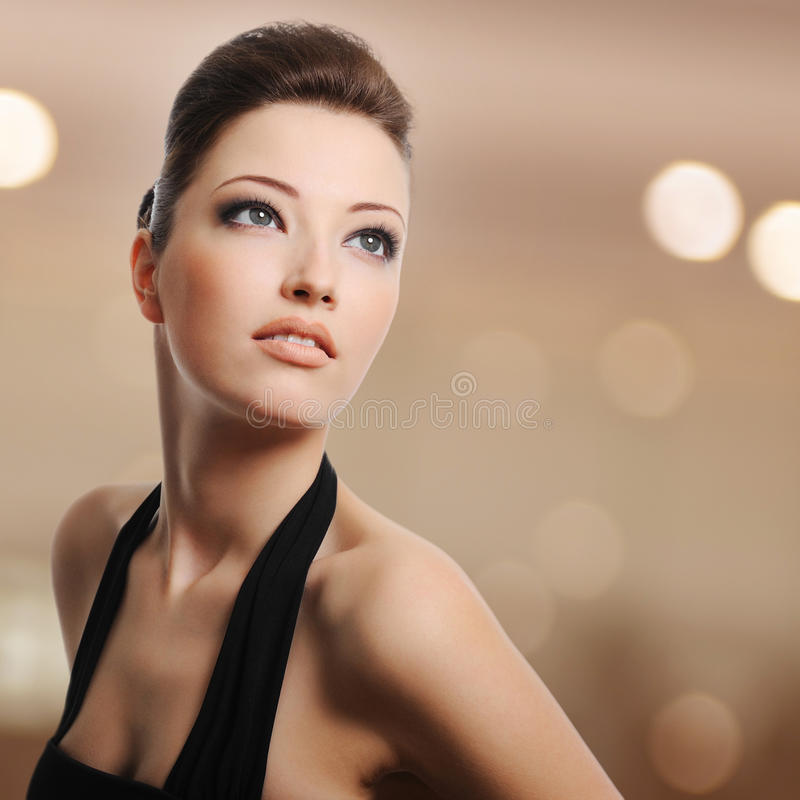 Beautiful young woman lookin away stock images
