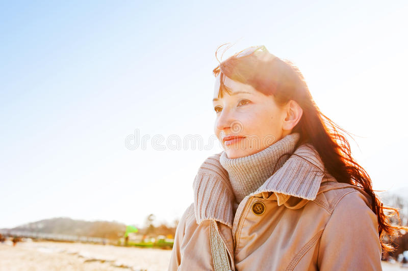Beautiful young woman looking at the sky, sunny day. royalty free stock image