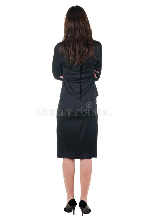 Beautiful young woman looking at wall. Rear view. Isolated over royalty free stock image