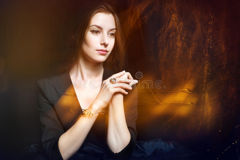 Beautiful young woman with luminous twinkle trail royalty free stock photography