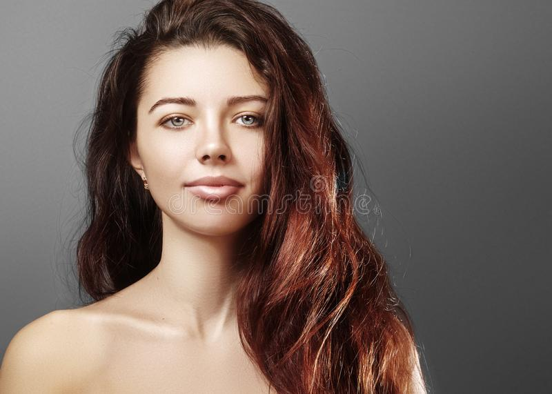 Beautiful young woman with luxury hair style and fashion gloss makeup. Beauty closeup model with long volume hair stock photos