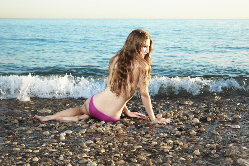 Download Beautiful Young Woman Lying On The Beach Stock Photo - Image: 21649118