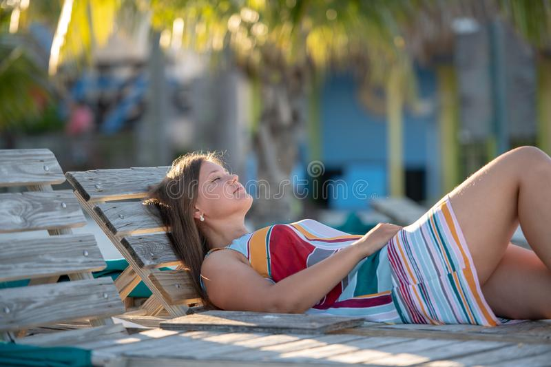 Pretty young woman lying on the beach royalty free stock photography
