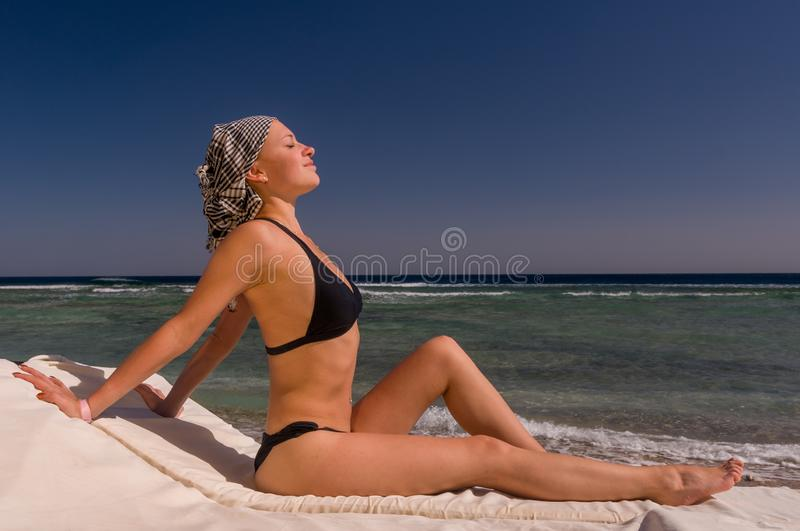 Beautiful young woman at the beach royalty free stock photography