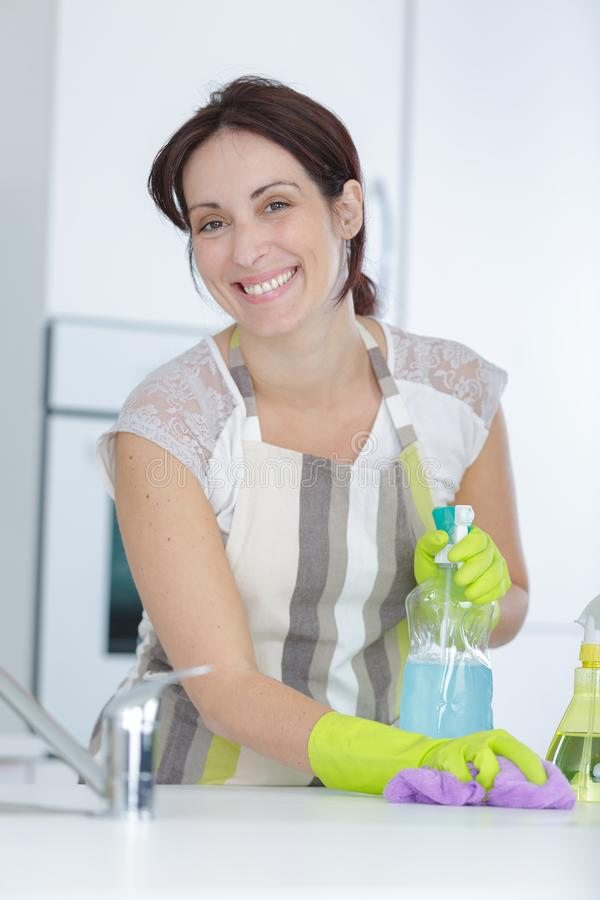 Beautiful young woman makes cleaning house royalty free stock photos