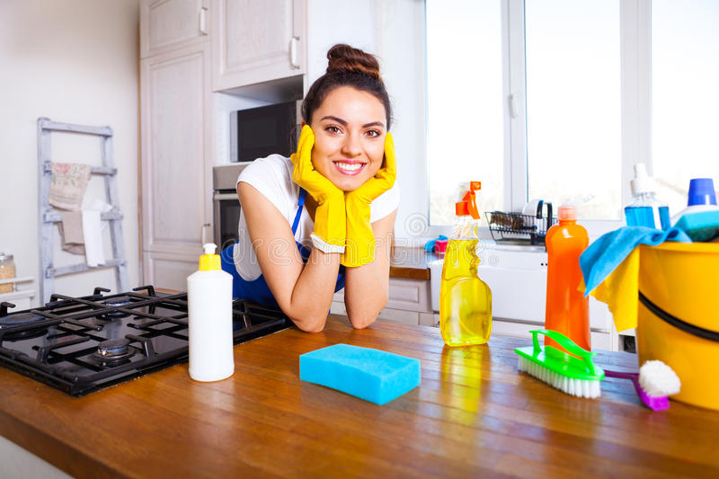 Beautiful young woman makes cleaning the house. Girl cleaning kitchen. Set. royalty free stock images
