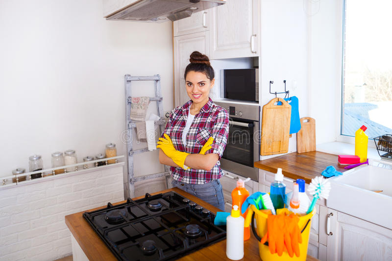 Beautiful young woman makes cleaning the house. Girl cleaning kitchen. Set. royalty free stock image