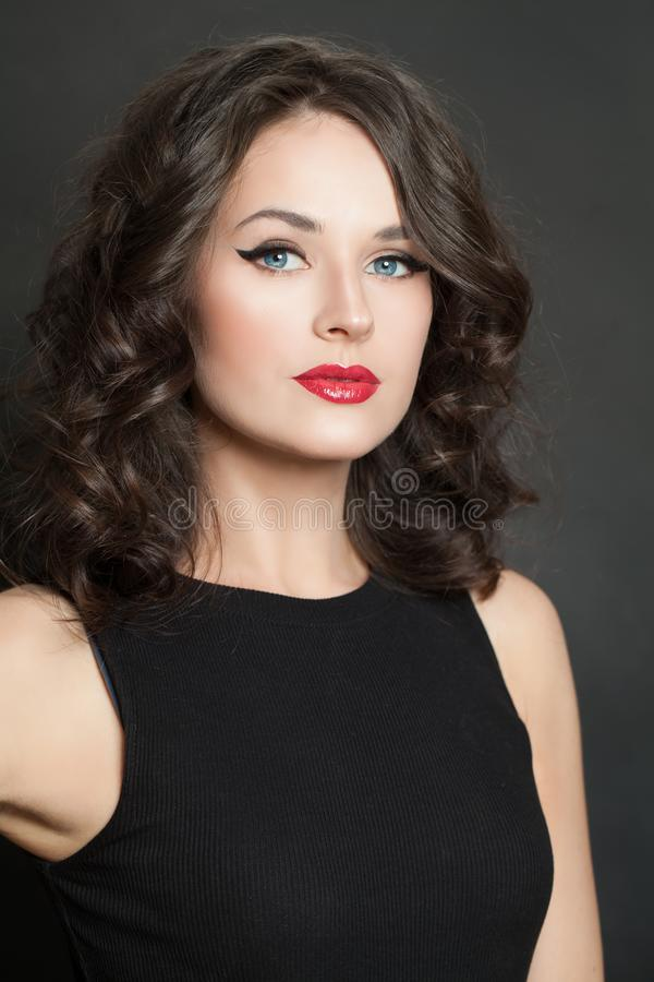 Beautiful young woman with makeup and curly hair closeup portrait stock images