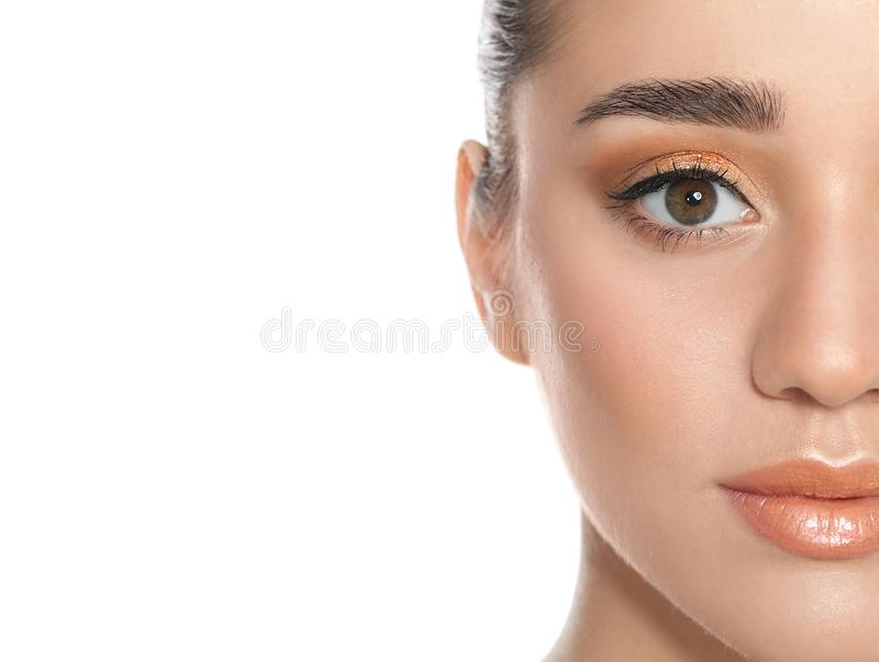 Beautiful young woman with  makeup on white background, closeup view royalty free stock images