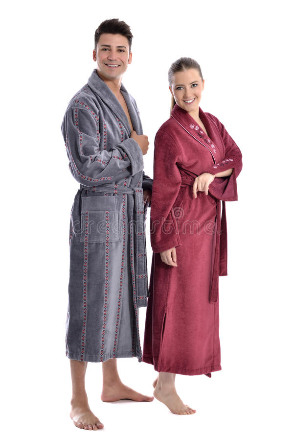 Beautiful young woman and man in bathrobe royalty free stock photo