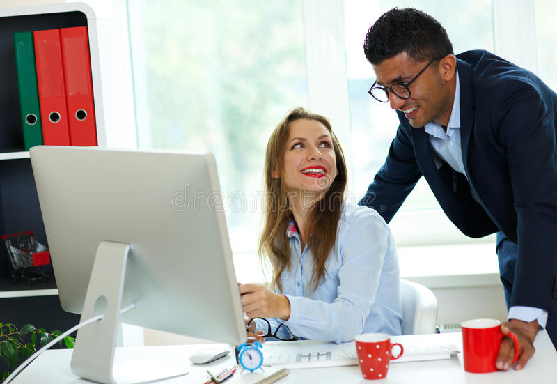 Beautiful young woman and man working from home office. Beautiful young women and men working from home office - modern business concept stock image
