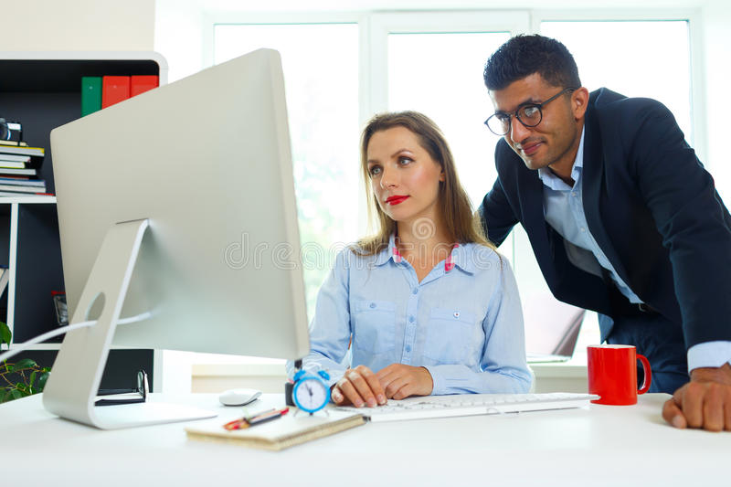 Beautiful young woman and man working from home office. Beautiful young women and men working from home office - modern business concept stock photos