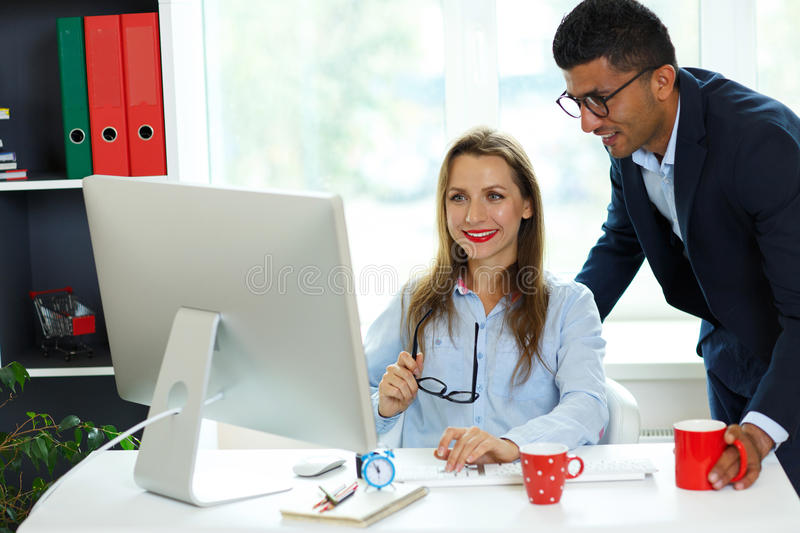 Beautiful young woman and man working from home office. Beautiful young women and men working from home office - modern business concept stock images
